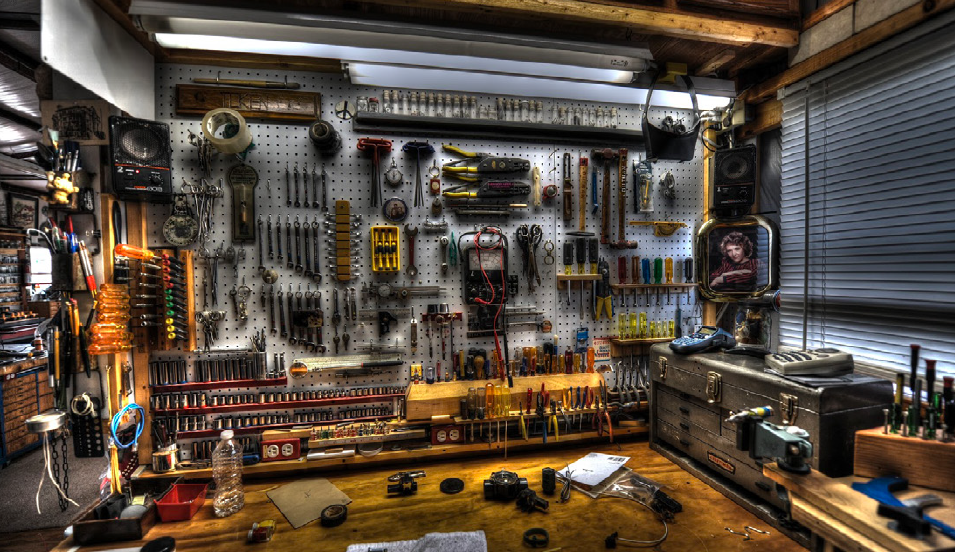 A workshop with all its tools elegantly arranged within easy reach.