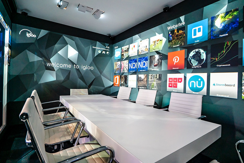 An Igloo immersive workspace with digital applications shown on the walls.
